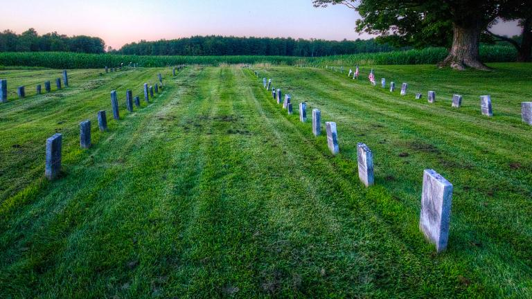 A cemetery with rows of headstones.