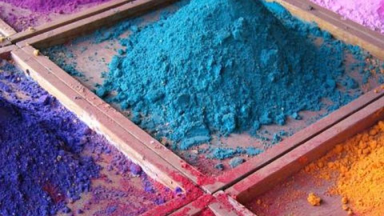 Pigments for sale on market stall, Goa, India.