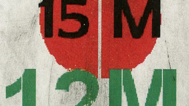 "A sticker with the text ""15 M"" and ""12 M""."
